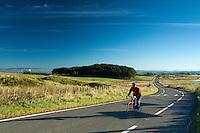 A cyclist cycling across Eaglesham Moor, Eaglesham, East Renfrewshire