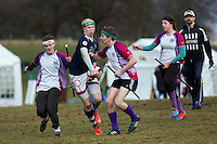 08 MAR 2015 - NOTTINGHAM, GBR - Tom Heynes (second from the left) from Radcliffe Chimeras forces his way through Loughborough Longshots players during their 2015 British Quidditch Cup semi final at Woollaton Hall and Deer Park in Nottingham, Great Britain (PHOTO COPYRIGHT © 2015 NIGEL FARROW, ALL RIGHTS RESERVED)