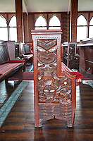 Cultural Syncretism: Maori Figures Carved on Anglican Church Pews and Woodwork.  St. Faith's Church, Ohinemutu Village, Rotorua, north island, New Zealand.
