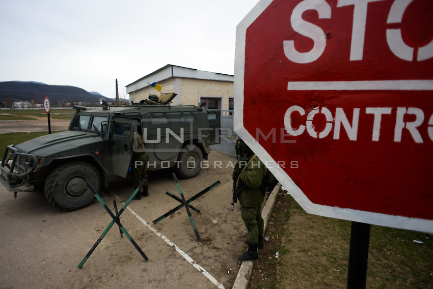 Soldiers in Russian uniform secures the perimeter of the occupied Ukrainian military base in Perevalnoe