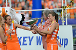The Hague, Netherlands, June 14: Kim Lammers #23 of The Netherlands takes a deeper look at the World Cup Trophy during the field hockey gold medal match (Women) between Australia and The Netherlands on June 14, 2014 during the World Cup 2014 at Kyocera Stadium in The Hague, Netherlands. Final score 2-0 (2-0)  (Photo by Dirk Markgraf / www.265-images.com) *** Local caption ***