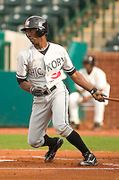 Hickory center fielder Andrew McCutchen (1) follows through on his swing versus Greensboro at First Horizon Park in Greensboro, NC, Thursday, June 8, 2006.  Hickory defeated Greensboro 5-4 in 8 innings.