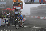 Linus Gerdemann (GER) Team Milram crosses the summit finish of the Col du Tourmalet during a wet foggy Stage 17 of the 2010 Tour de France running 174km from Pau to Col du Tourmalet, France. 22nd July 2010.<br /> (Photo by Eoin Clarke/NEWSFILE).<br /> All photos usage must carry mandatory copyright credit (© NEWSFILE | Eoin Clarke)