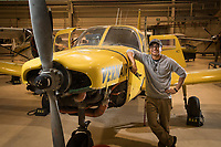 Aviation Maintenance student Desmond Corpuz with a donated Piper Cherokee used by his class at UAA's Aviation Technology Complex on Merrill Field.