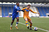 George Maris of Mansfield Town and Callum Harriott of Colchester United during Colchester United vs Mansfield Town, Sky Bet EFL League 2 Football at the JobServe Community Stadium on 14th February 2021