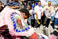 A Mardi Gras Indian surrounded by revelers in downtown New Orleans on February 28, 2006.