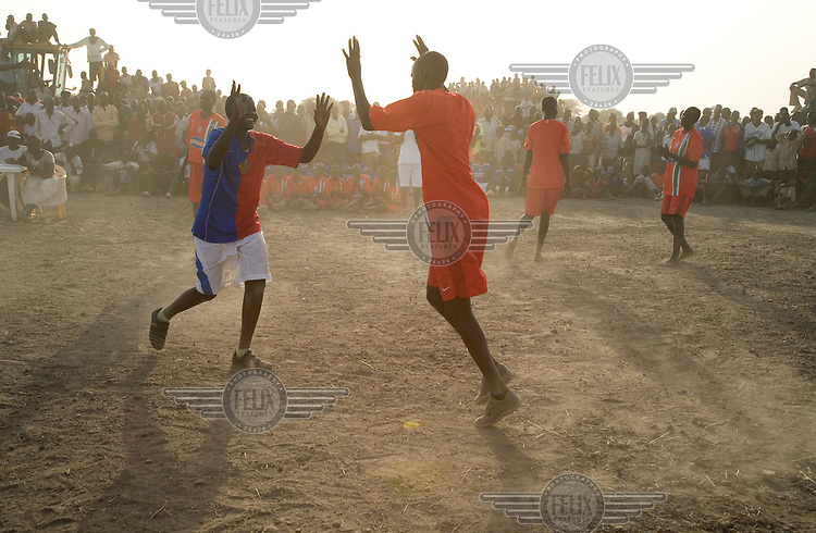 The Turalei women's volleyball team celebrate a point, at the Twic Olympics in Wunrok, Southern Sudan.