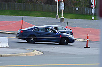 Landover, MD - March 24, 2020: Police help to secure the entrance to a COVID-19  health screening site in a parking lot at FedEx Field in Landover, MD, March 24, 2020. The site is not available for drive up screenings.  (Photo by Don Baxter/Media International)