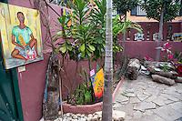 Courtyard Displaying Painting by Dakar Artist Bakary Diop--Young Man with his Islamic Prayer Board, Goree Island, Senegal.