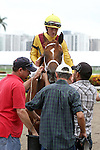 September 06, 2014:  Scenes from Gulfstream Park.  2 year old,  Free Flying (FL) with jockey Ramsey Zimmerman on board breaks her maiden in race 9,  at Gulfstream Park in Hallandale Beach FL. Liz Lamont/ESW/CSM