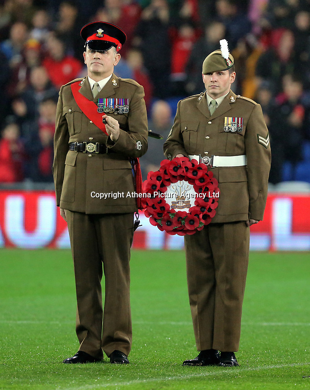 Members of the Armed Forces with a wreath during the international friendly soccer match between Wales and Panama at Cardiff City Stadium, Cardiff, Wales, UK. Tuesday 14 November 2017.
