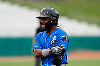 Biloxi Shuckers first baseman Luis Castro (4) shares a smile during the game against the Tennessee Smokies on May 18, 2021, at Smokies Stadium in Kodak, Tennessee. (Danny Parker/Four Seam Images)