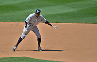 16 June 2012: New York Yankees outfielder Curtis Granderson in action against the Washington Nationals at Nationals Park in Washington, DC. The Yankees defeated the Nationals in 14 innings by a score of 5-3, taking the second game of their 3-game series. Mandatory Credit: Ed Wolfstein Photo