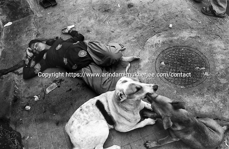 INDIA (West Bengal - Calcutta) - Lolita overdrunk lying on a footpath at Munsigaunge red light area in Calcutta. Lolita had to sexually entertain 11 customers in the last night. Sometimes it is very painful for them both mentally and physically.   - Arindam Mukherjee