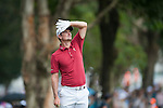 Justin Rose of England looks at his last shot during Hong Kong Open golf tournament at the Fanling golf course on 25 October 2015 in Hong Kong, China. Photo by Xaume Olleros / Power Sport Images