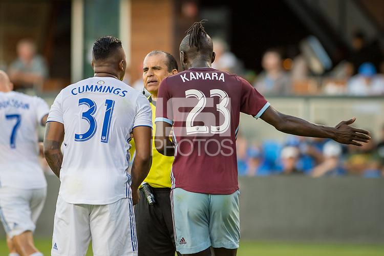 SAN JOSÉ CA - JULY 27: Harold Cummings #31, referee Baldomero Toledo, Kei Kamara #23 during a Major League Soccer (MLS) match between the San Jose Earthquakes and the Colorado Rapids on July 27, 2019 at Avaya Stadium in San José, California.