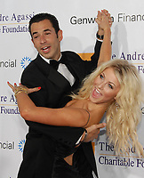 LAS VEGAS - OCTOBER 06, 2007: IndyCar champ Helio Castroneves (L) and dancer Julianne Hough arrive at the Andre Agassi Charitable Foundation's 12th Annual Grand Slam for Children at the MGM Grand Garden Arena on October 6, 2007 in Las Vegas, Nevada. The Andre Agassi Charitable Foundation was created to provide recreational and educational opportunites for at-risk children in Southern Nevada. <br /> <br /> People:   Helio Castroneves; Julianne Hough