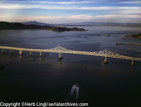 aerial photograph of a tug boat approaching the Richmond Bridge, Contra Costa county California