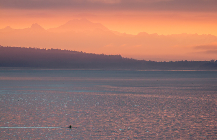 Rower, sculling, sunrise, Cascade Mountains, Puget Sound, Port Townsend,Washington State, Pacific Northwest, USA