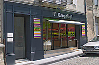 A very modern designed wine shop and bar cafe on one of the main streets in Saint Emilion called L'Essentiel (The Essential) and a door leading to the Thunevin company owning Chateau Valandraud Saint Emilion Village Bordeaux Gironde Aquitaine France