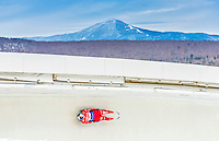 5 December 2014: Dominik Fischnaller, sliding for Italy, slides through Curve Number 14 on his first run, ending the day with a 3rd place finish and a combined 2-run time of 1:43.181 in the Men's Competition at the Viessmann Luge World Cup, at the Olympic Sports Track in Lake Placid, New York, USA. Mandatory Credit: Ed Wolfstein Photo *** RAW (NEF) Image File Available ***