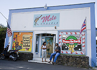 Two friends outside Mele Ukulele store in Wailuku, Maui