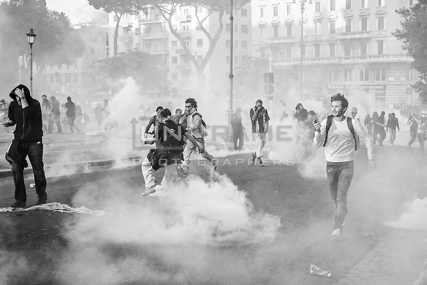Dense white clouds of tear gas are released by the canisters fired by the riot police in the attempt to disperse the rioters in piazza San Giovanni during the clashes triggered by organized violent fringes of protesters.  Rome, Italy. 15/10/2011