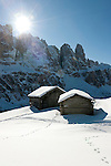 Italy, Alto Adige, South Tyrol, above Selva di Val Gardena: snowed in hay huts and Gruppo del Sella mountains   Italien, Suedtirol, Groednertal, oberhalb Wolkenstein: eingeschneite Heuhuetten vor Sella Gruppe