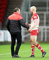 20th November 2020; Totally Wicked Stadium, Saint Helens, Merseyside, England; BetFred Super League Playoff Rugby, Saint Helens Saints v Catalan Dragons; St. Helens's Head Coach Kristian Woolf shakes hands with Kyle Amor of St Helens as the players leave the field