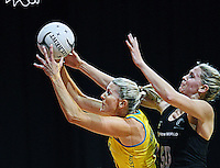 Australia's Cath Cox, left, gets the ball ahead of New Zealand's Casey Williams in the New World Quad series netball match, Claudelands Arena, Hamilton, New Zealand, Thursday, November 01, 2012. Credit:NINZ / Dianne Manson.