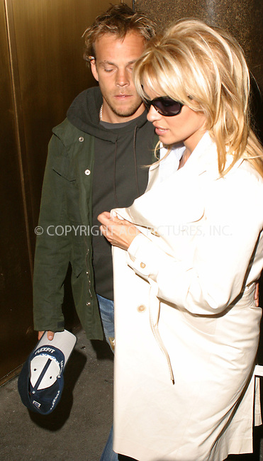 WWW.ACEPIXS.COM . . . . .  ....NEW YORK, APRIL 1, 2005....Pamela Anderson and Stephen Dorff seen exiting their midtown hotel.....Please byline: PAUL CUNNINGHAM - ACE PICTURES..... *** ***..Ace Pictures, Inc:  ..Craig Ashby (212) 243-8787..e-mail: picturedesk@acepixs.com..web: http://www.acepixs.com