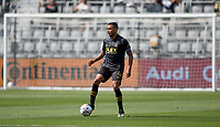 LOS ANGELES, CA - APRIL 17: Eddie Segura #4 of LAFC moves with the ball during a game between Austin FC and Los Angeles FC at Banc of California Stadium on April 17, 2021 in Los Angeles, California.