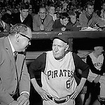 Pittsburgh PA:  Public Relations man Bill Wilde talking with all-time great Pie Trainor in the dugout at the HYPO charity baseball game with the Cleveland Indians.<br /> The money raised by HYPO (Help Young Players Organize) was used to help local communities buy equipment and build ball fields
