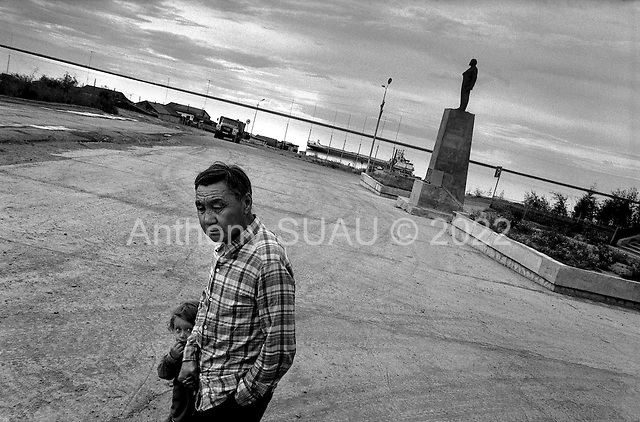 Yukutia.Siberia, Russia.1995.In the port city of Cherski thousands of people have moved out since the fall of the USSR. It once was a booming port town but is now left to abandon. Some hope that the opening of the northern sea route will save it.