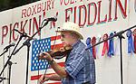 ROXBURY CT. 11 July 2015-071115SV01-Rejean Paquet of Naugatuck plays a song during the annual Pickin' 'N' Fiddlin' fundraiser at Hurlburt Park in Roxbury Saturday.<br /> Steven Valenti Republican-American