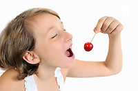 Girl (10) holding a cherry, mouth wide open (Licence this image exclusively with Getty: http://www.gettyimages.com/detail/103301306 )