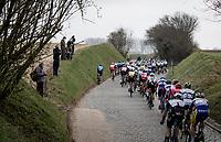 peloton over the Holleweg cobbles<br /> <br /> 76th Omloop Het Nieuwsblad 2021<br /> ME(1.UWT)<br /> 1 day race from Ghent to Ninove (BEL): 200km<br /> <br /> ©kramon