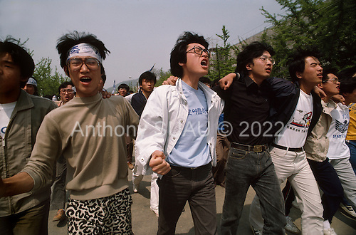 """Seoul, South Korea.May 9, 1987..Students hold a violent anti-government protests at Yunsei University...After two decades of building an economic miracle, in the summer of 1987 tens of thousands of frustrated South Korean students took to the streets demanding democratic reform. """"People Power"""" Korean-style saw Koreans from all social spectrums join in the protests...With the Olympics to be held in South Korea in 1988, President Chun Doo Hwan decided on no political reforms and to choose the ruling party chairman, Roh Tae Woo, as his heir. The protests multiplied and after 3 weeks Chun conceded releasing oppositionist Kim Dae Jung from his 55th house arrest and shaking hands with opposition leader Kim Young Sam. Days later he endorsed presidential elections and an amnesty for nearly 3,000 political prisoners. It marked the first initiative of democratic reform in South Korea and the people had their victory."""