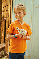 A young boy with a chick