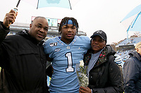 CHAPEL HILL, NC - NOVEMBER 23: Myles Dorn #1 of the University of North Carolina poses with his parents Torin Dorn, a former UNC and NFL football player, and Rhonda Dorn while being honored as part of UNC Senior Day during a game between Mercer University and University of North Carolina at Kenan Memorial Stadium on November 23, 2019 in Chapel Hill, North Carolina.