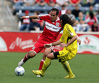 Chicago Fire midfielder Cuauhtemoc Blanco (10) makes a move against Columbus Crew defender Gino Padula (4).  The Columbus Crew tied the Chicago Fire 2-2 at Toyota Park in Bridgeview, IL on September 20, 2009.