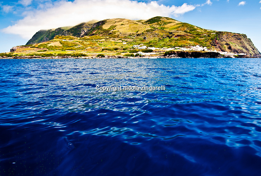View of the island of Corvo, east of Flores island at the Azores. The island is very tiny yet quite tall and is a great spot for divers and fishermen