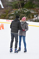 A guy proposing to his girlfriend on Wollman Rink, Central Park