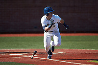 McCann Mellett (9) of the Wingate Bulldogs hustles down the first base line against the Concord Mountain Lions at Ron Christopher Stadium on February 2, 2020 in Wingate, North Carolina. The Mountain Lions defeated the Bulldogs 12-11. (Brian Westerholt/Four Seam Images)