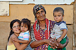 Ganime Makmovida, 68, poses with members of her family in the largely Roma neighborhood of Gorno Ezerovo, part of the Bulgarian city of Burgas. Residents here don't self-identify much as Roma, because of the negative connotations associated with the word, so many refer to themselves as a Turkish-speaking minority. This woman participates in the local United Methodist congregation.