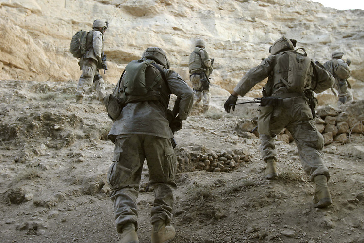 BARWANA, Iraq- Marines from Weapons Company, 1st Light Armored Reconnaissance Battalion climb up a steep hillside during a patrol. The Marines of Regimental Combat Team 2 conduct counter-insurgency operations with Iraqi Security Forces to isolate and neutralize anti-Iraqi forces, to support the continued development of Iraqi Security Forces, and to support Iraqi reconstruction and democratic elections in order to create a secure environment that enables Iraqi self-reliance and self-governance. (Official USMC photo by Lance Cpl. Shane S. Keller)