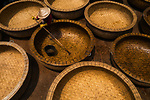 """A worker lines the inside of an intricately woven bamboo basket with oil at a workshop in Chi Thanh, Vietnam where they make boats in the traditional way.<br /> <br /> The moment was captured by photographer Pham Quoc Hung, showing a worker during the process of making a basket boat, a traditional form of boat native to Vietnam. <br /> <br /> Mr Hung said """"The workers over the course of a few weeks will cut the bamboo, dry it, interweave it and then smear the oil over it.  The oil comes from a large tree called dipterocarpus retusus. This will protect it and make it water resistant"""". <br /> <br /> """"The boats sell for anywhere between £30-160 GBP"""". <br /> <br /> Please byline: Pham Quoc Hung/Solent News<br /> <br /> © Pham Quoc Hung/Solent News & Photo Agency<br /> UK +44 (0) 2380 458800"""