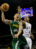 Lithuania guard (4) Rimantas Kaukenas drives to the basket past US forward (4) Carlos Boozer while playing at the Cotai Arena inside the Venetian Macau Resort and Hotel.  The US defeated Lithuania, 120-84.