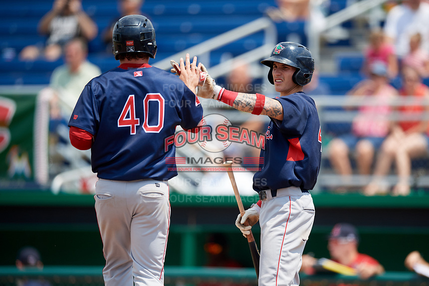 Lowell Spinners Jarren Duran (right) high fives Tyler Esplin (40) after scoring a run during a game against the Batavia Muckdogs on July 15, 2018 at Dwyer Stadium in Batavia, New York.  Lowell defeated Batavia 6-2.  (Mike Janes/Four Seam Images)