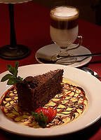 illustration photo<br /> A piece of chocolate cake sit in a plate beside a Cappuccinno coffee in a Montreal Italian restaurant<br /> <br /> NOTE : D-1 Tiff opened as NTSC, saved as Adobe RBG Jpeg
